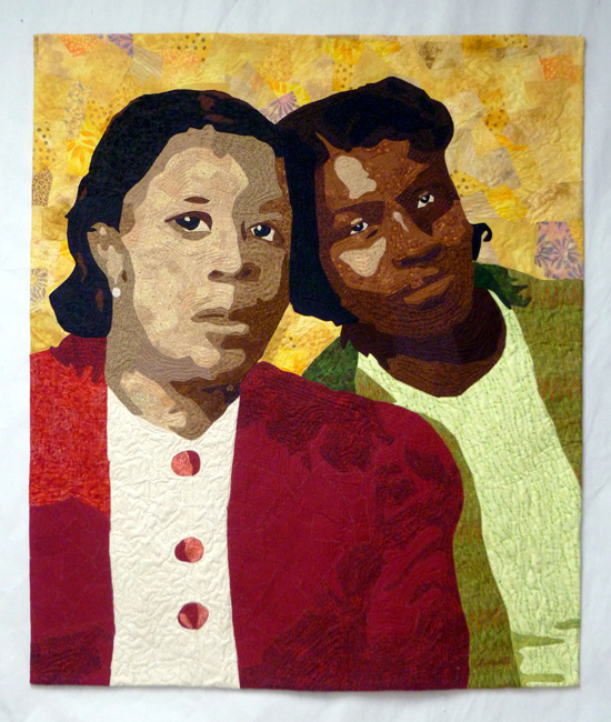 Quilted portait of two african-american sisters